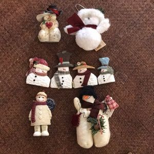 5 winter snowman's for decoration all have a scarf